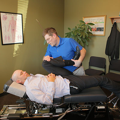 Chiropractor stretching out client